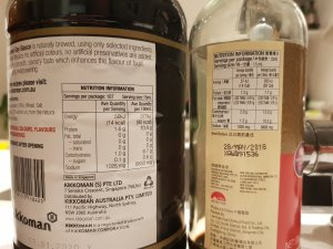 Two bottles of soy sauce and their nutritional panel