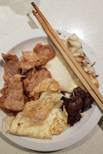 Cooked eggs, pork slices and some liver