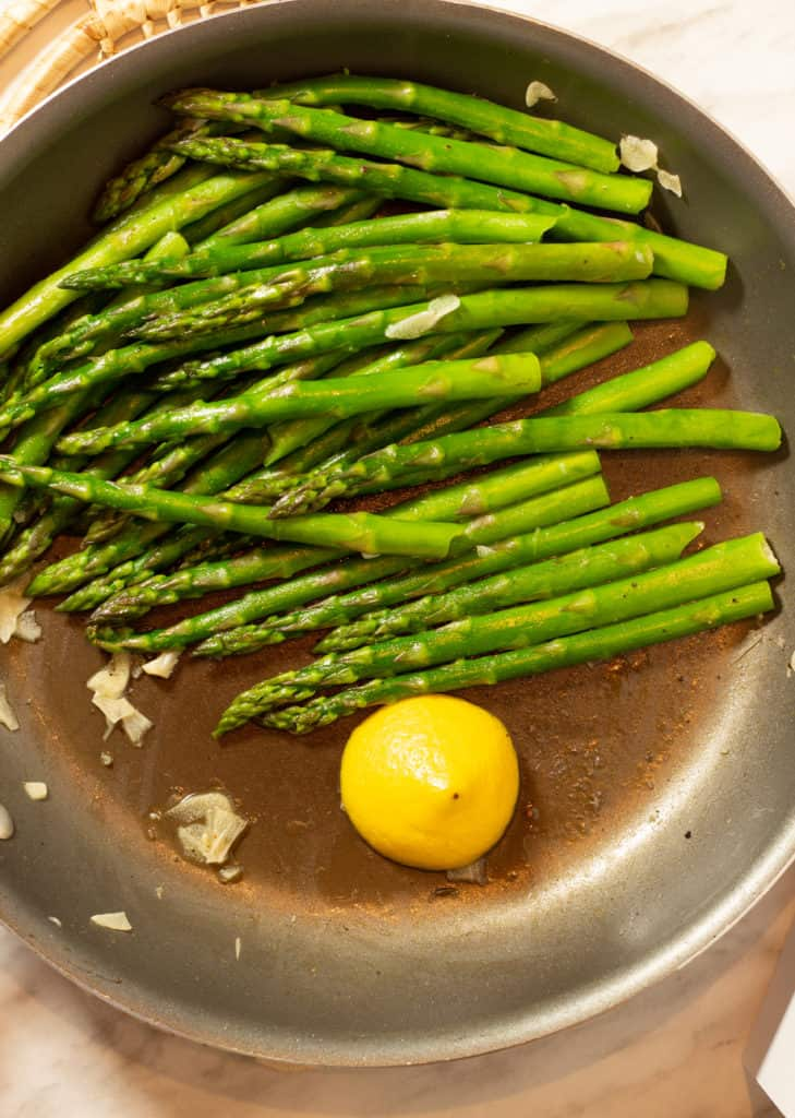 lemon, garlic, and asparagus in a skillet for keto pan-roasted asparagus recipe