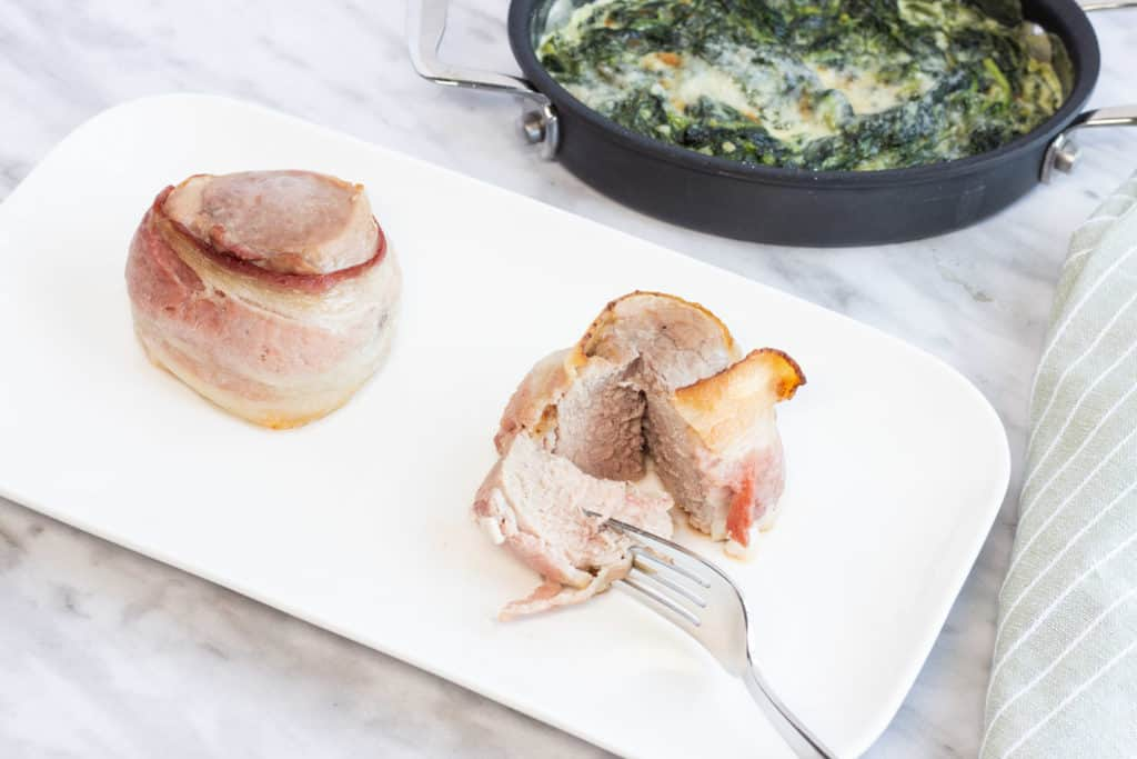 bacon wrapped pork tenderloin with creamed spinach