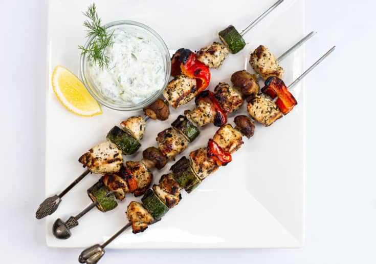 three keto and low carb lemon-oregano chicken kabobs with tzatziki on the side