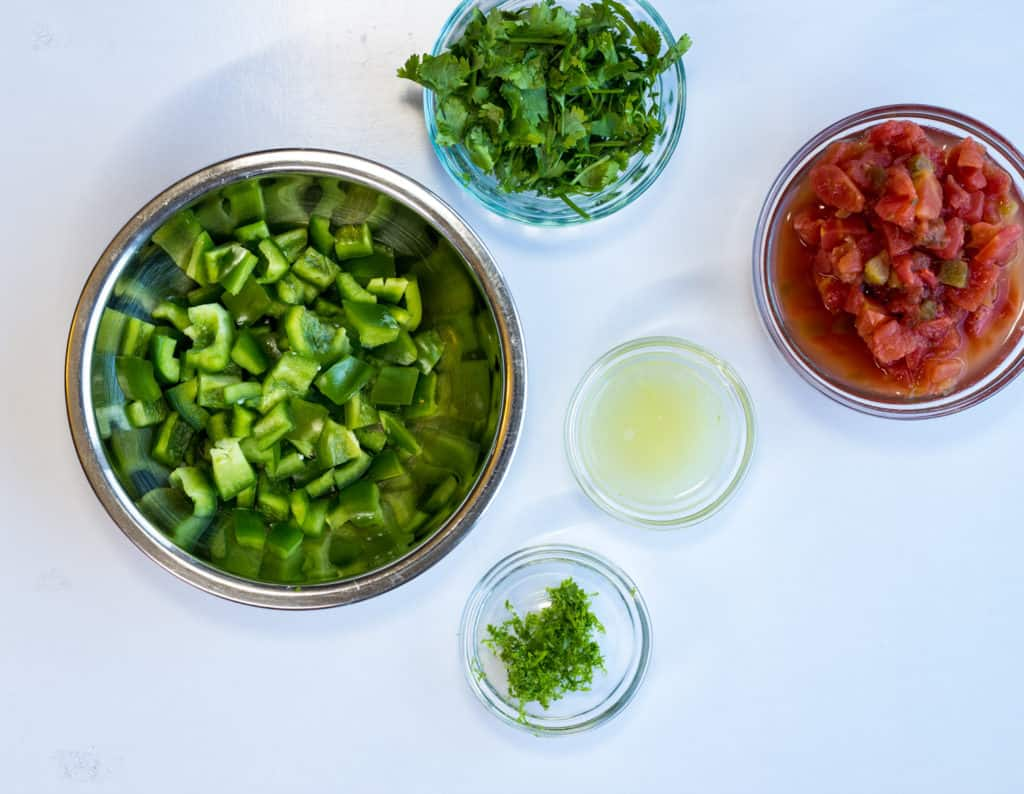 chopped bell pepper, zest and juice of lime, 1 can rotel tomatoes, and cilantro