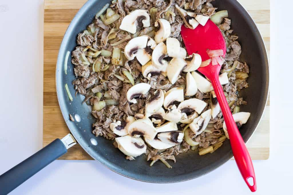 cooked onions, beef, and mushrooms