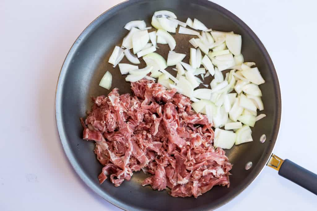 philly beef and onions in a skillet