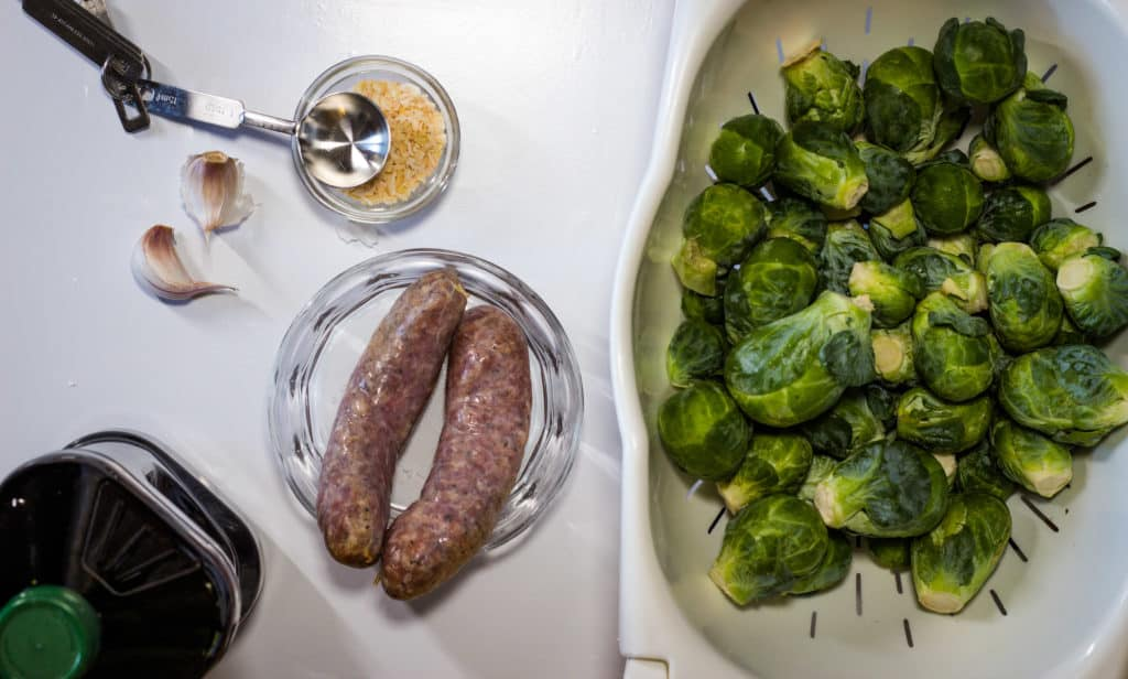 sausage, brussels sprouts, garlic, and onion - ingredients for Italian Brussels Sprouts with Sausage