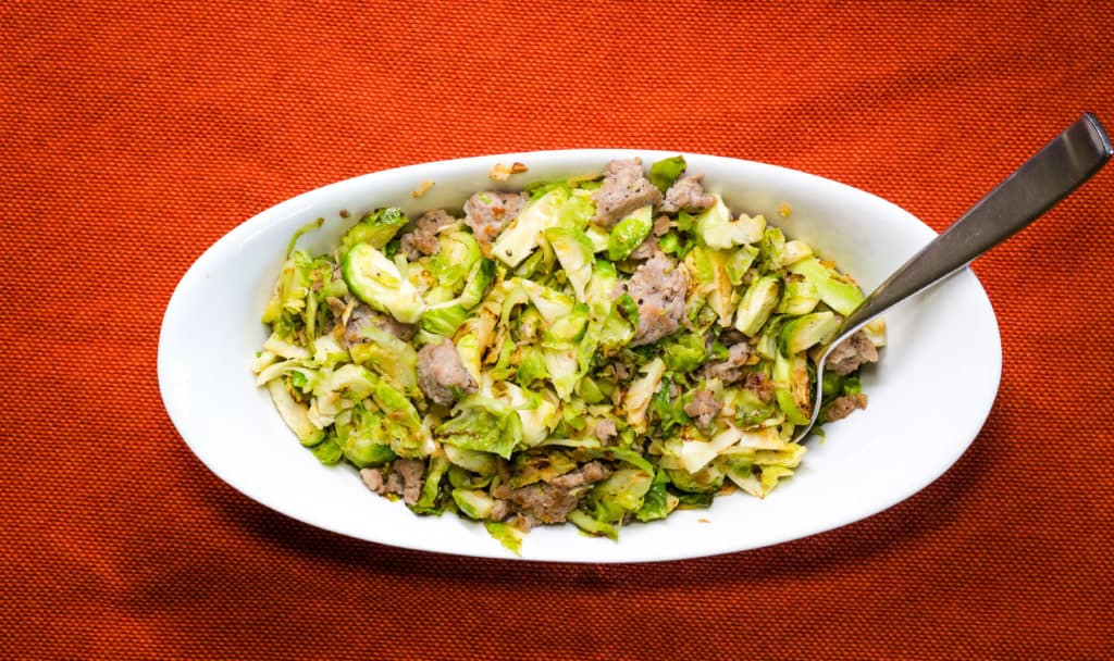Keto and low-carb Italian Brussels Sprouts with Sausage in a serving bowl