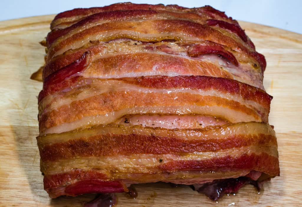 cooked whole bacon wrapped pork loin