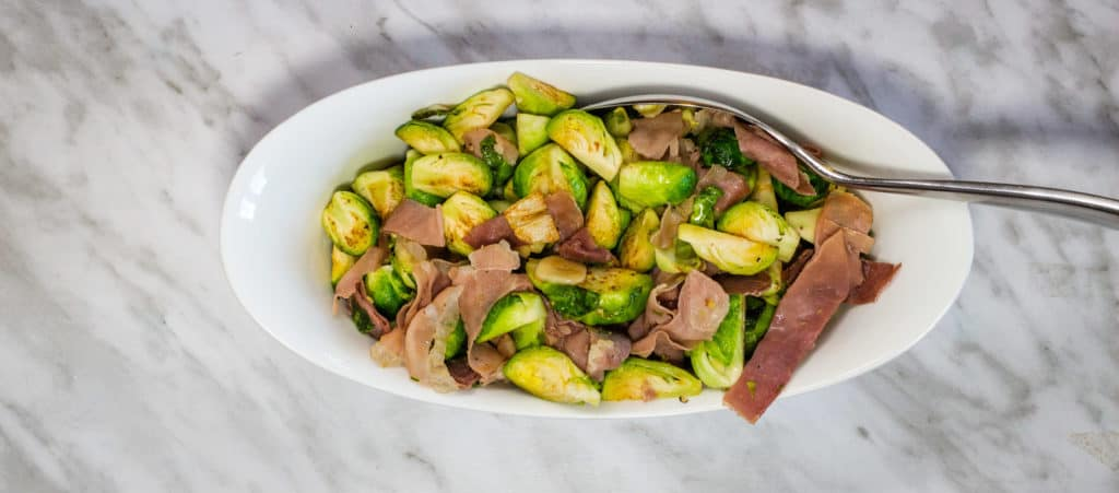 Brussels Sprouts with Prosciutto in a serving bowl