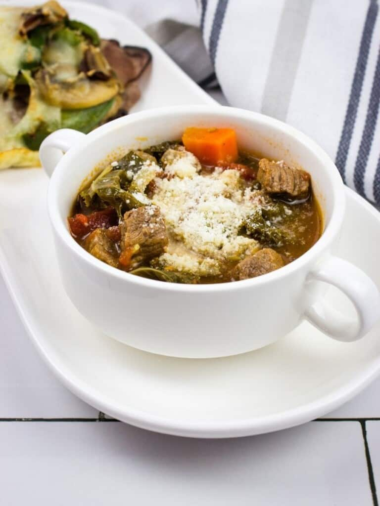 keto minestrone soup in a white soup cup