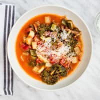 keto-friendly beefy minestrone soup with a sprinkle of cheese