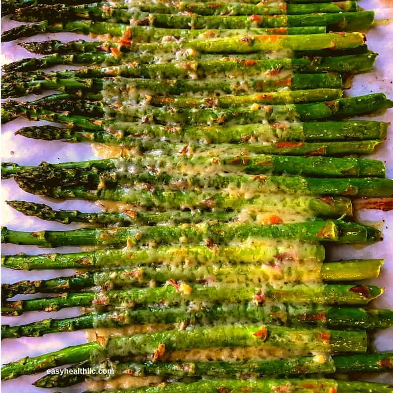 keto side dish recipe of cheesy roasted asparagus on a pan