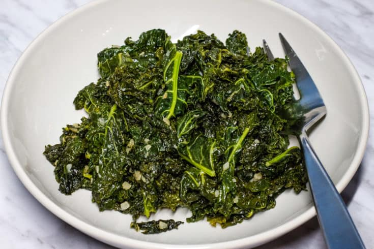 Skillet Braised Kale with Garlic in a serving dish.
