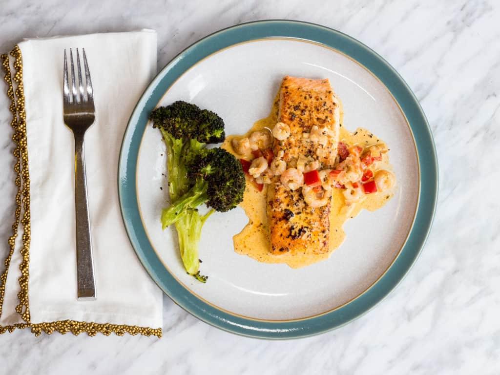 Keto cajun salmon with broccoli on a plate