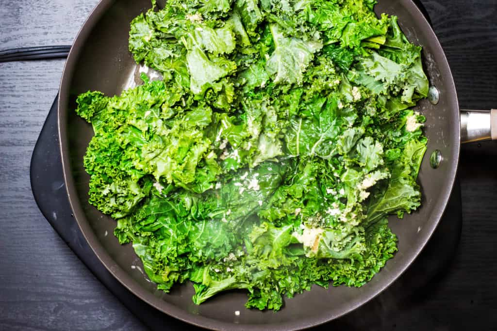 braised kale cooking in a skillet