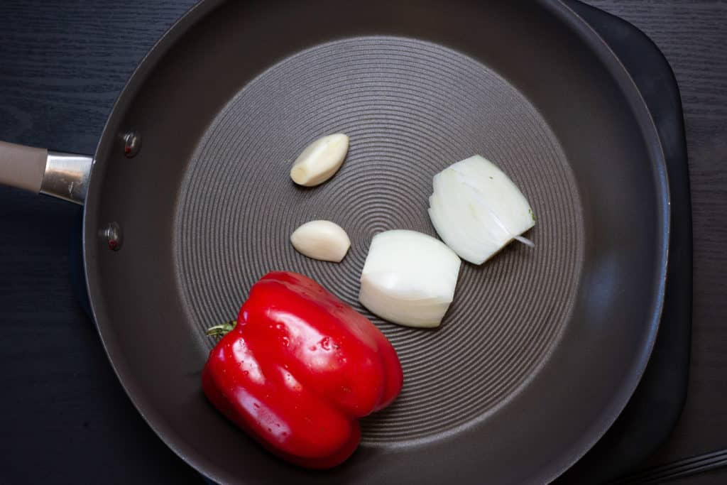 Red pepper, onion and garlic in a skillet