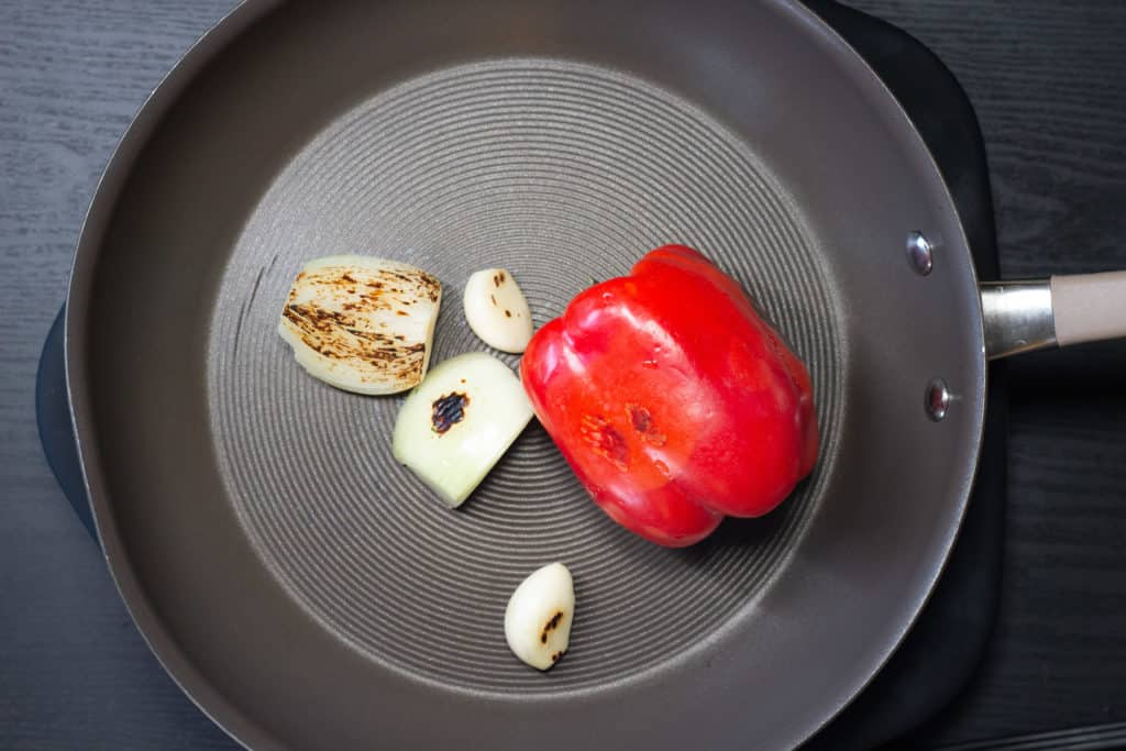 Red pepper, onion and garlic after roasting in a skillet