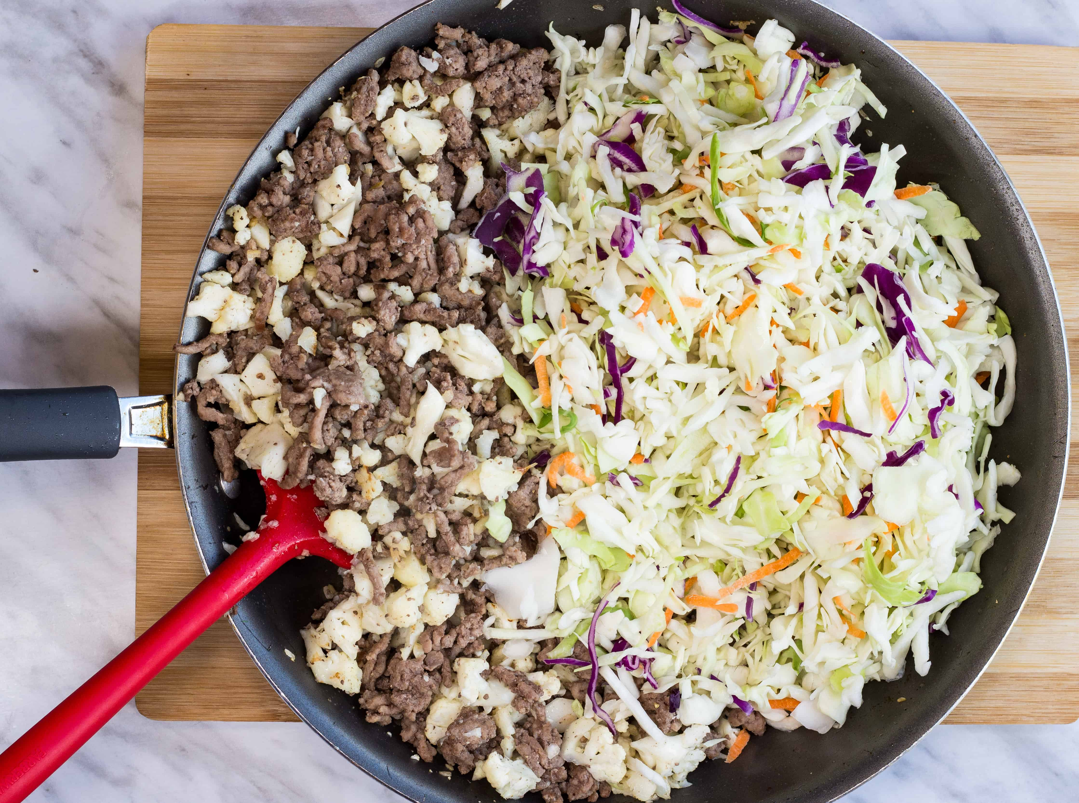 add the cabbage shreds to the skillet