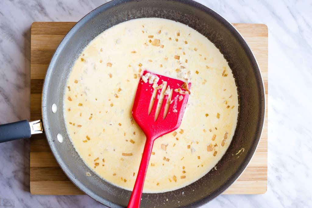 Making the cream sauce in a large skillet