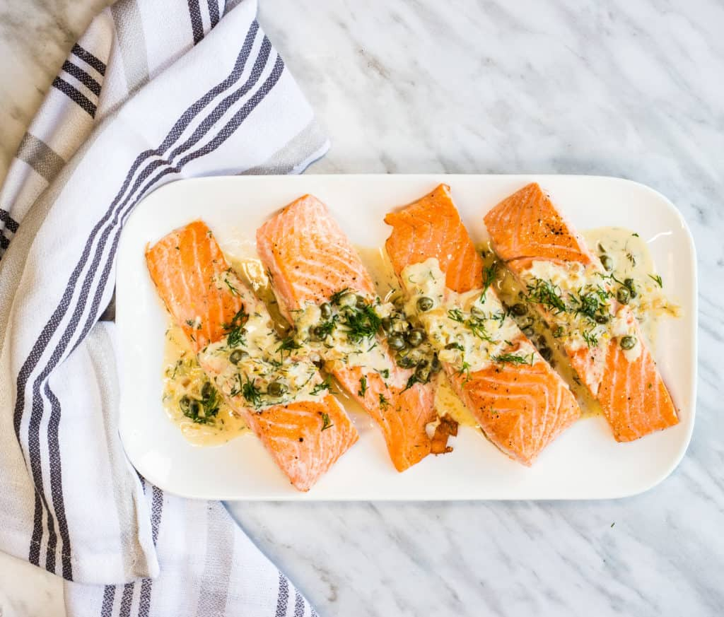 keto salmon with lemon dill cream sauce on a serving plate