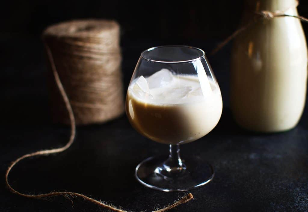Irish cream liqueur in a snifter glass with ice.
