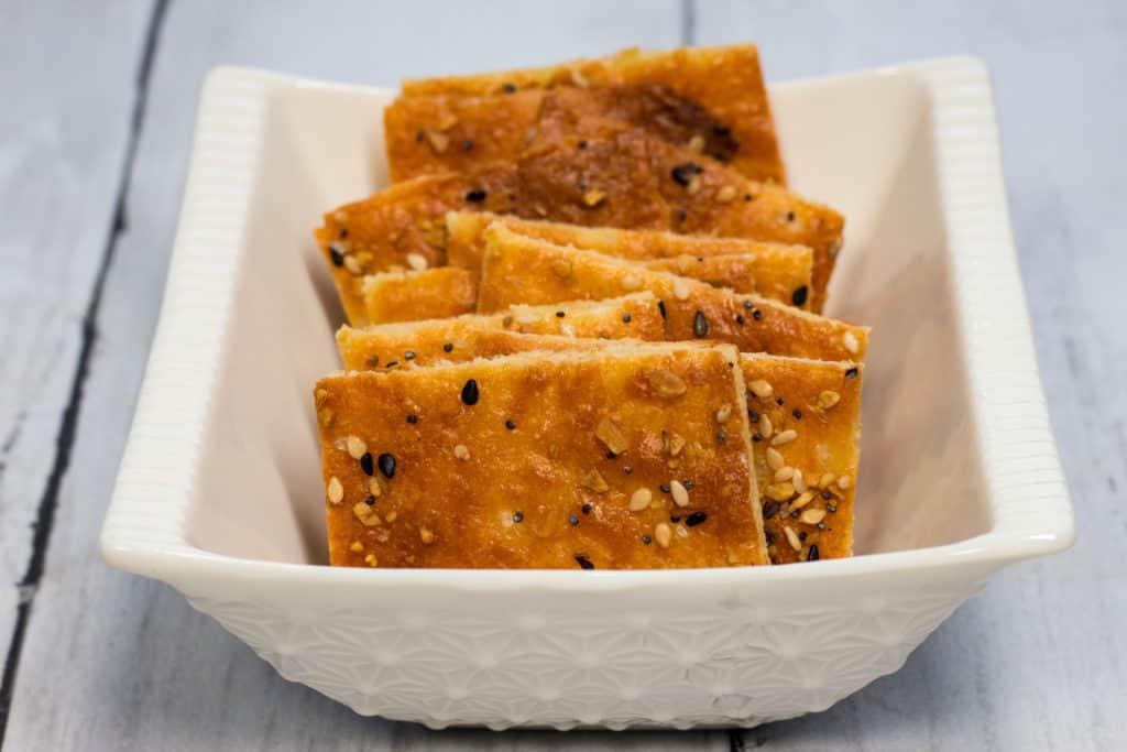 crispy keto cheesy crackers in a dish
