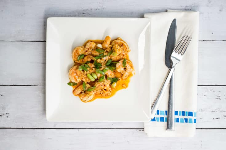 keto new orleans BBQ shrimp on a serving plate