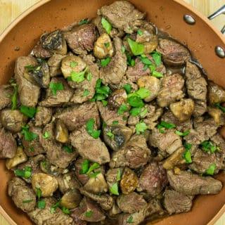 garlic steak & mushrooms in the pan