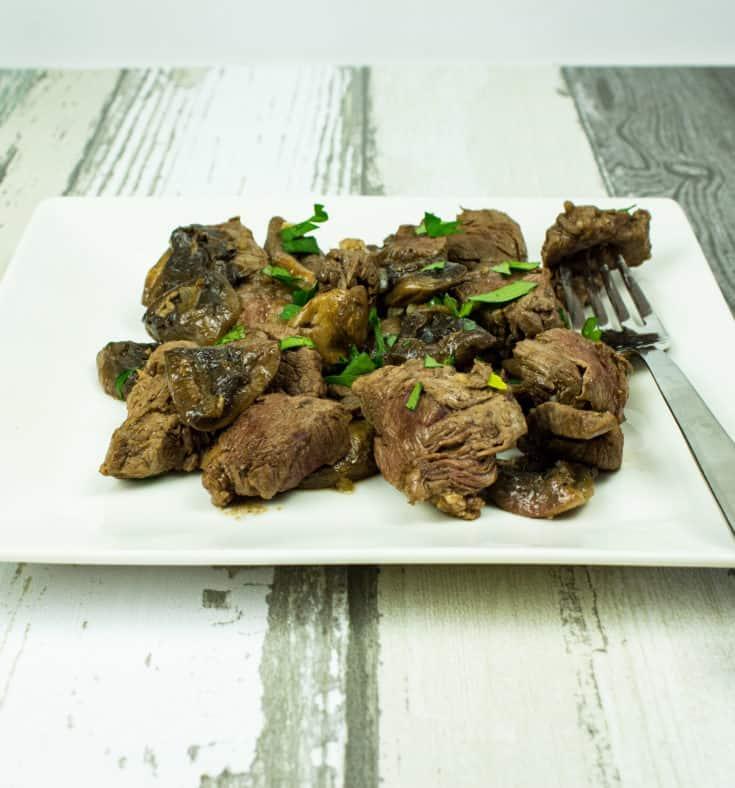 garlic steak & mushrooms on a plate