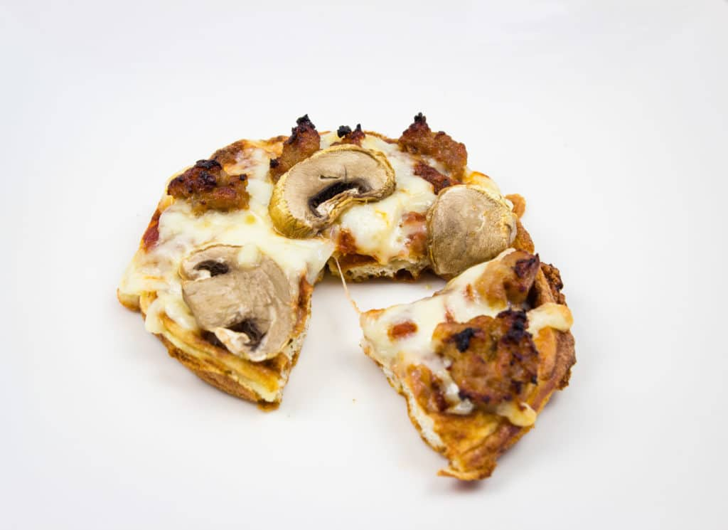 chaffle pizza topped with mushroom and sausage