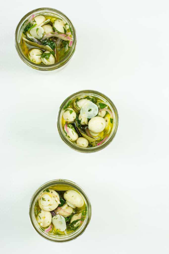 put the marinated mushrooms into jars