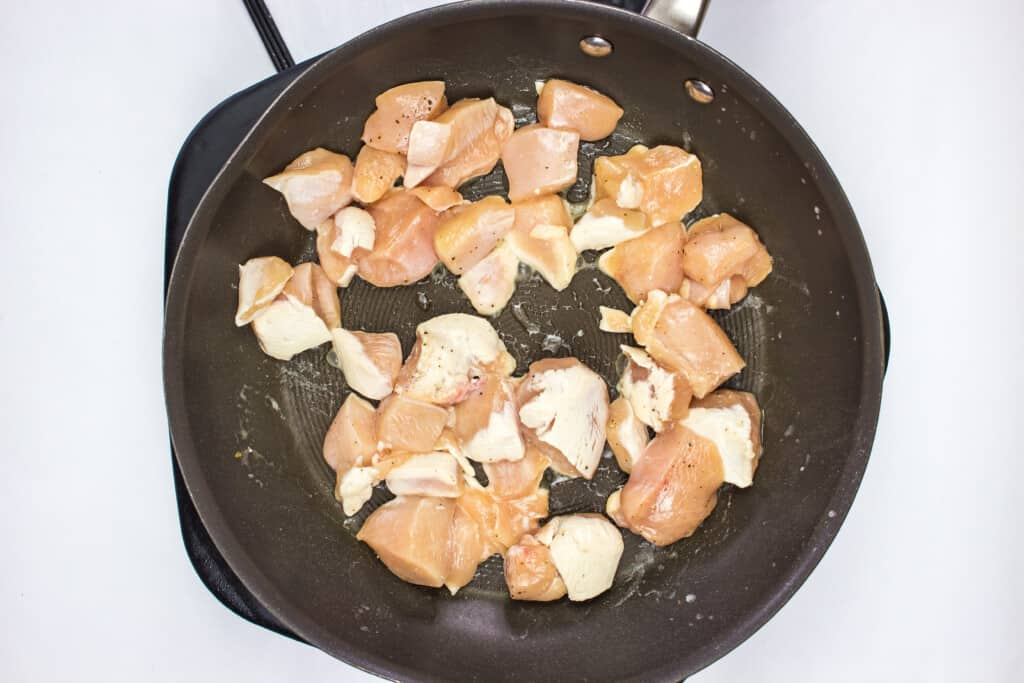 frying the chicken in butter and garlic