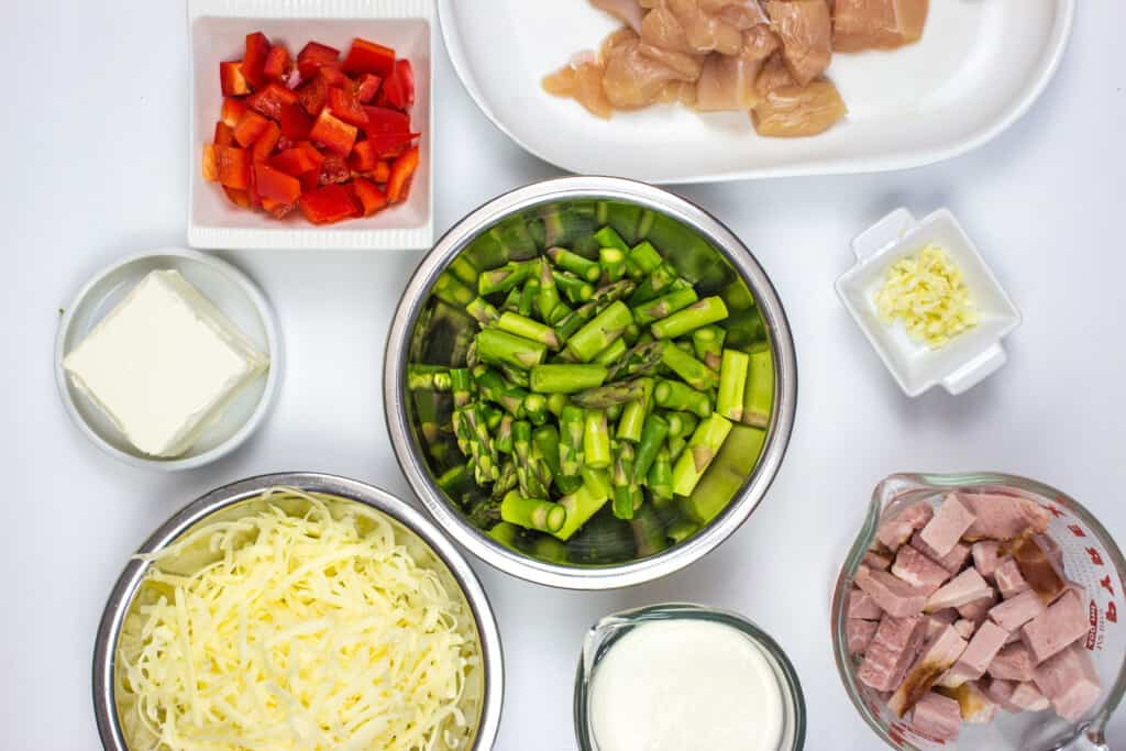 prepped ingredients - diced chicken, ham, asparagus, bell peppers and more