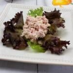ham and pickle salad on a plate with lettuce