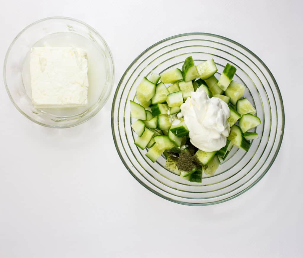 Mix the sour cream and dill with the cucumberes
