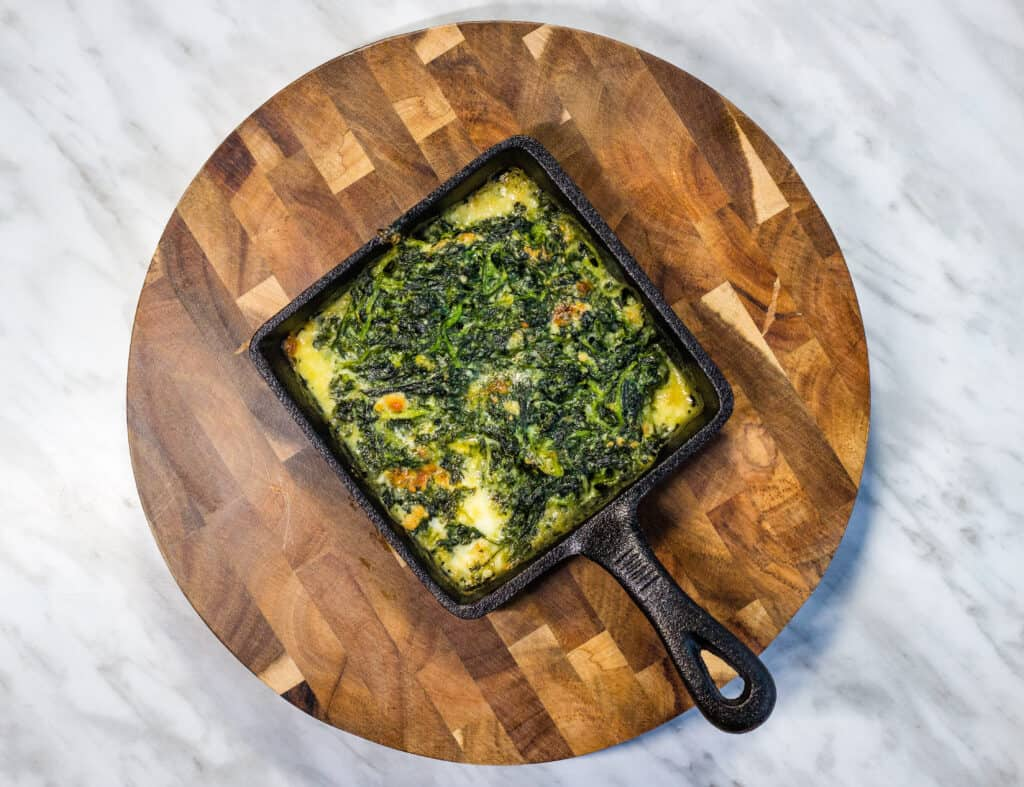steakhouse creamed spinach in a square serving dish