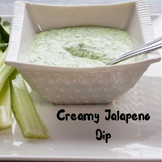 creamy keto jalapeno dip in a square bowl with a spoon