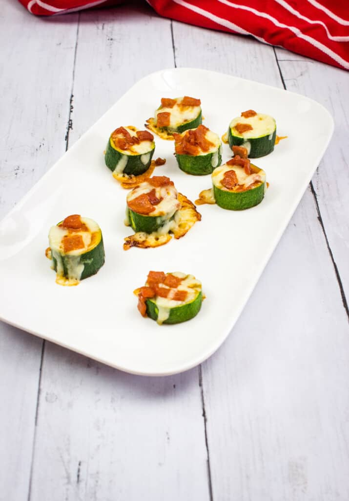 Zucchini pizza bites on a rectangular platter