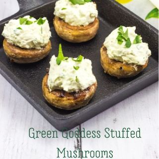 keto green goddess stuffed mushrooms in a black cast iron pan