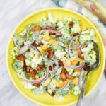 keto broccoli salad with bacon in a yellow bowl
