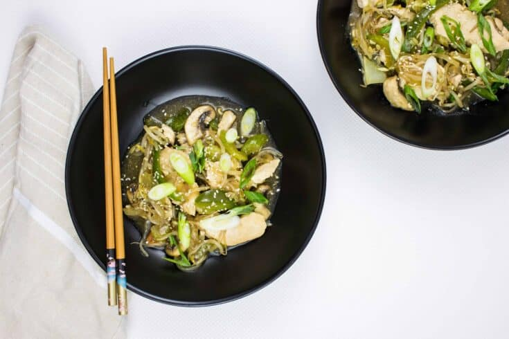 two servings of keto chicken stir fry on black plates