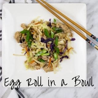 egg roll in a bowl on a plate with chopsticks