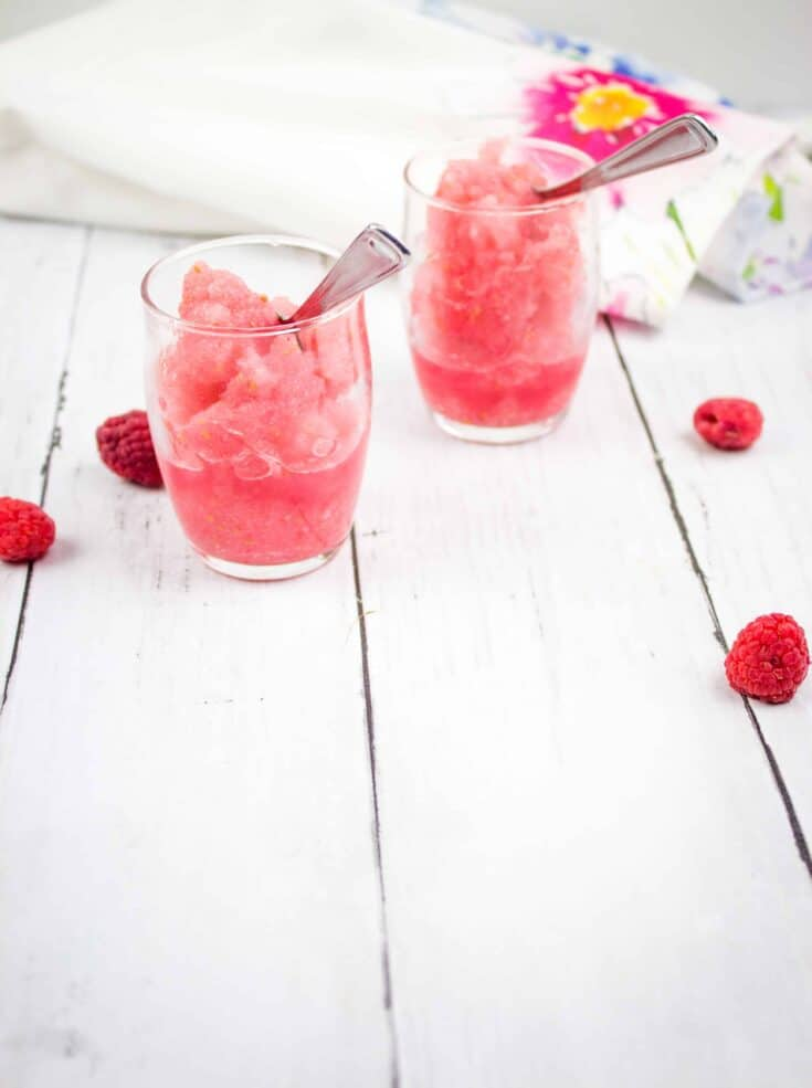frozen raspberry vodka slushes in glasses with spoons