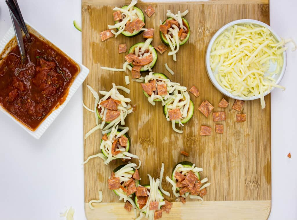 top each zucchini bite with cheese and your favorite toppings