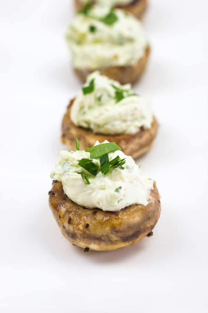 green goddess stuffed mushrooms on a plate