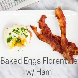 baked eggs florentine with ham on a plate with bacon