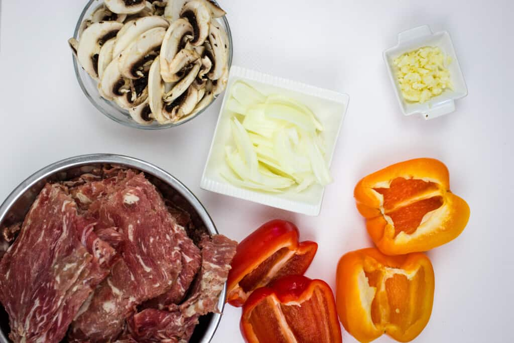 prepped ingredients to make keto philly cheesesteak stuffed peppers