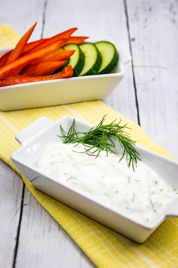 tzatziki sauce keto in a dish with veggies on the side