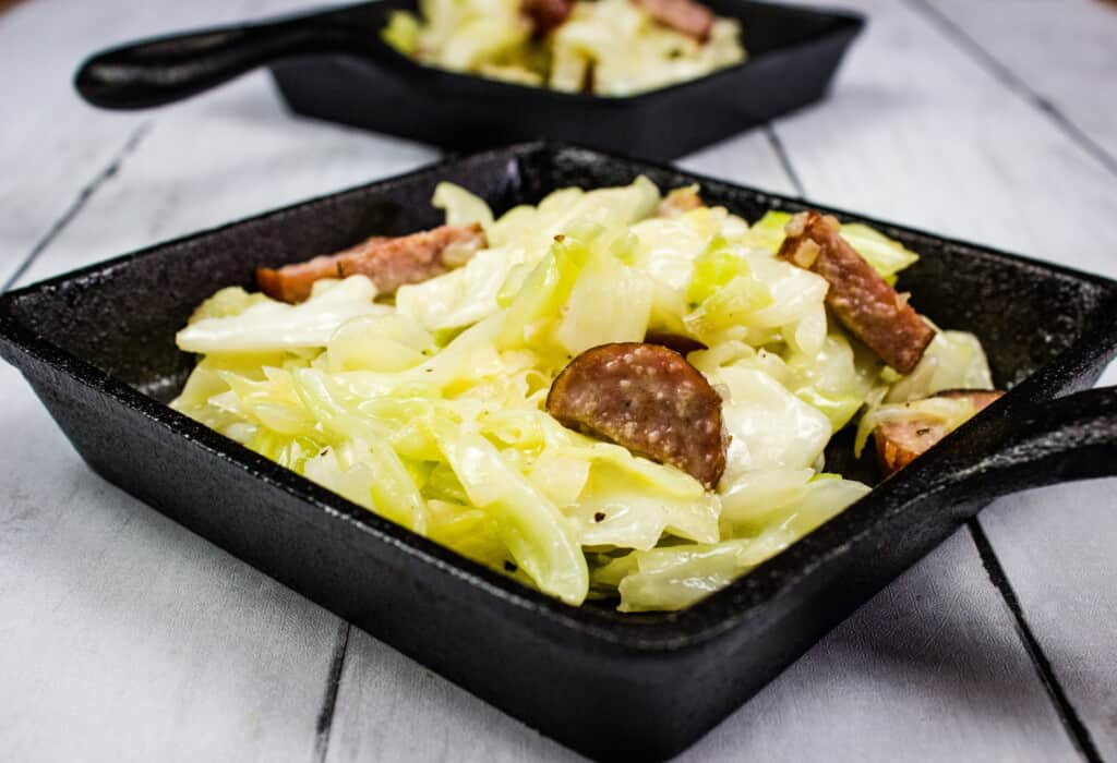 keto cabbage and sausage side dish in a square skillet