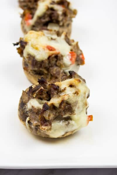keto philly cheesesteak stuffed mushroom caps on a serving plate