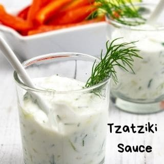 tzatziki sauce in small glasses with veggies